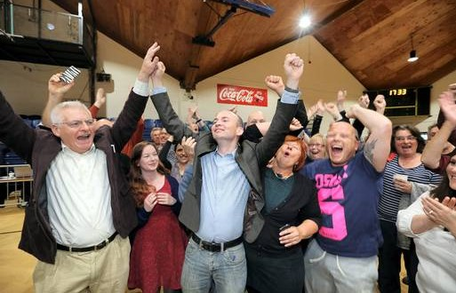 Paul Murphy (centre) following the by election victory