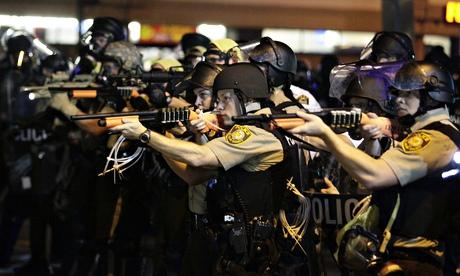 Police confront protestors in Ferguson after the verdict