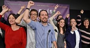 Podemos' Pablo Iglesias (centre) following the election results